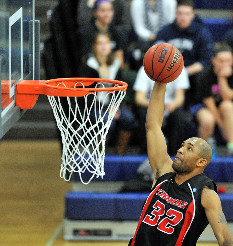 TO THE HOLE: Thomas College's Martin Cleveland dunks the ball in the first half against Colby College earlier this season at Wadsworth Gymnasium at Colby College in Waterville.
