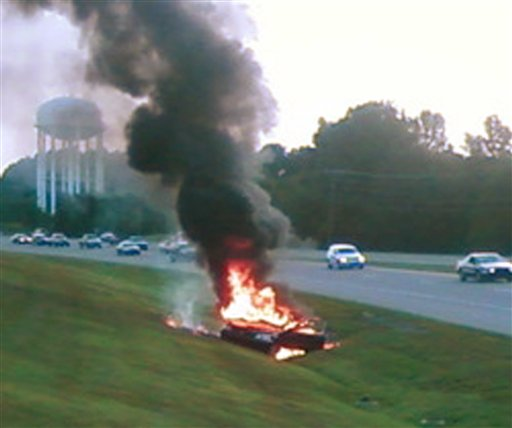 This dashboard police video image shows what authorities say is a mobile shake-and-bake meth lab vehicle burning last August in Clarksville, Tenn.