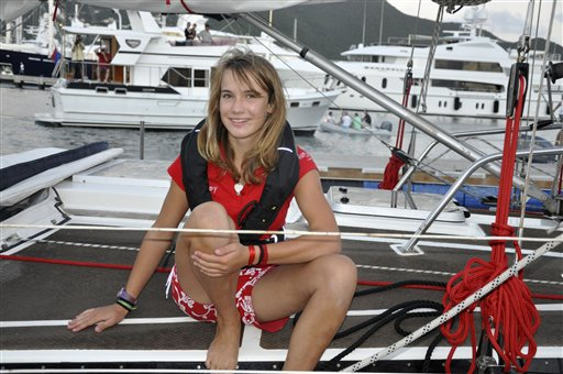 In this Dec. 19, 2010, photo, Laura Dekker poses on her sailboat Guppy at the place where she started her round-the-world voyage on Jan. 20, 2011.: Simpson Bay Lagoon near Philipsburg on the Caribbean island of St. Maarten.