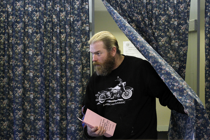 Terry Whipple steps out of a voting booth at the Woodstock Town Hall in Woodstock, N.H., today after casting his vote in the first-in-the-nation presidential primary.
