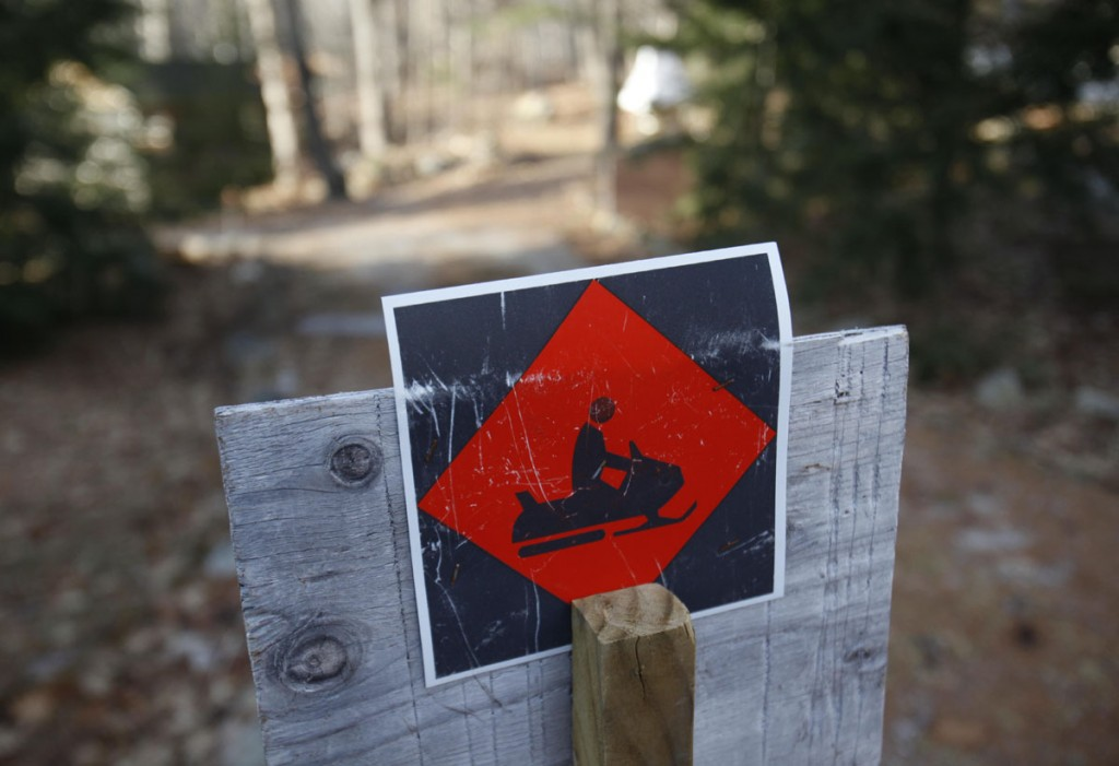 A snowmobile trail sign marks a trail in Bridgton. Snow lovers are still waiting for the white stuff throughout much of the Northeast.