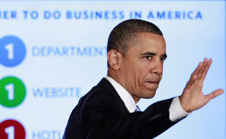 President Barack Obama waves after delivering remarks on government reform today in the East Room of the White House.