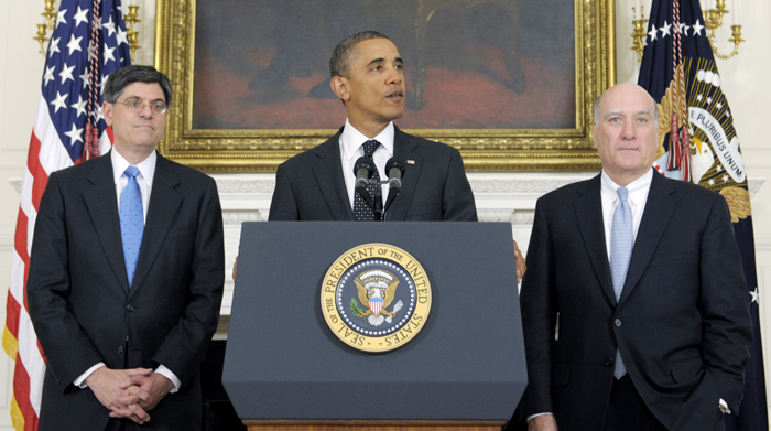 President Barack Obama is flanked today by outgoing White House Chief of Staff William Daley, right, and his replacement, current Budget Director Jack Lew.