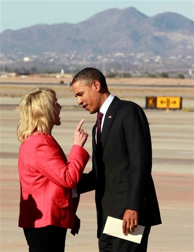 Arizona Gov. Jan Brewer points at President Barack Obama after he arrives at Phoenix-Mesa Gateway Airport on Wednesday. The two leaders engaged in an intense conversation at the base of Air Force One's steps and both could be seen smiling, but speaking at the same time. Asked moments later what the conversation was about, Brewer, a Republican, said: