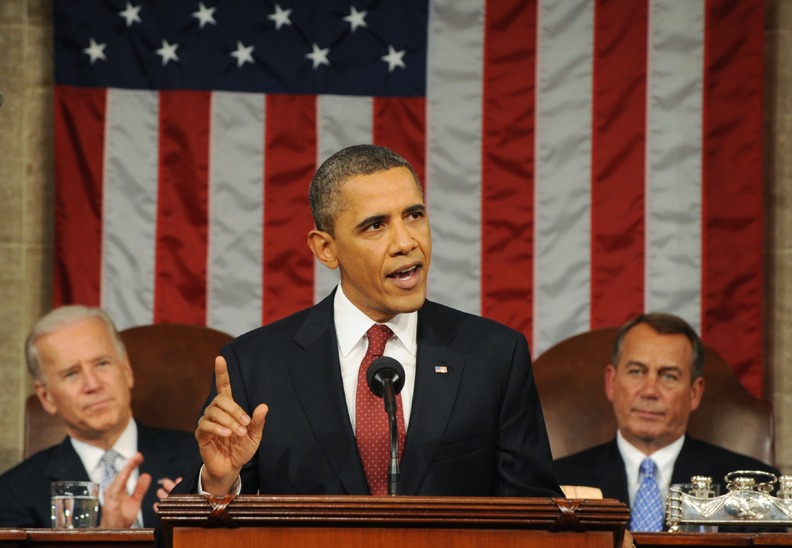 President Barack Obama delivers his State of the Union address on Capitol Hill in Washington tonight. Listening in back are Vice President Joe Biden and House Speaker John Boehner, right. HORIZONTAL