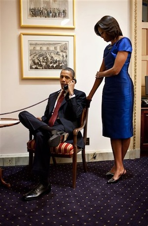 This photo provided by the White House shows President Barack Obama, accompanied by first lady Michelle Obama, during a phone call from the Capitol in Washington, Tuesday, Jan. 24, 2012, immediately after his State of the Union Address, informing John Buchanan that his daughter Jessica was rescued by U.S. Special Operations Forces in Somalia. (AP Photo/Pete Souza)