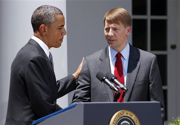 FILE - In this July 18, 2011 file photo, President Barack Obama shakes hands with former Ohio Attorney General Richard Cordray after announcing his nomination to serve as the first director of the Consumer Financial Protection Bureau (CFPB), in the Rose Garden of the White House in Washington. Senior administration officials tell The Associated Press that President Barack Obama will use a recess appointment to name Richard Cordray on Wednesday as the nation�s chief consumer watchdog despite steep Republican opposition. (AP Photo/Manuel Balce Ceneta, File)
