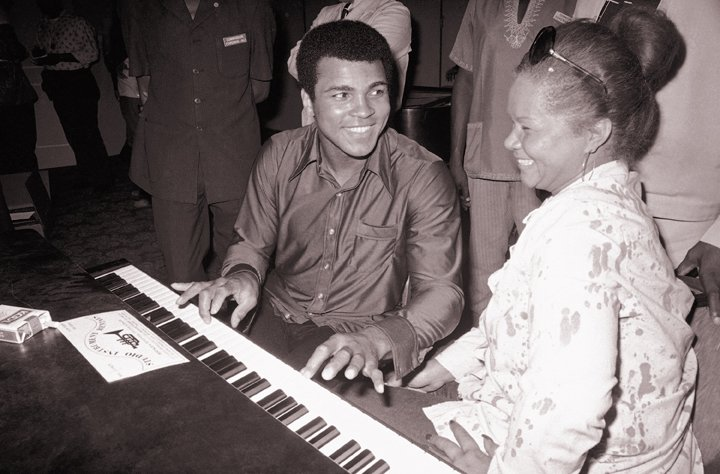 In this Sept. 22, 1974, photo, Muhammad Ali plays a few notes on the piano as singer Etta James looks on.