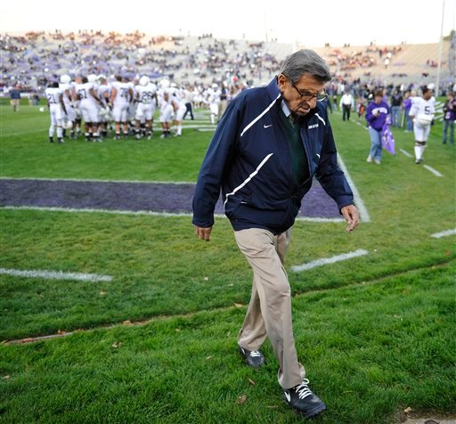In this Oct. 22, 2011, photo, Penn State coach Joe Paterno walks off the field after warmups before a game against Northwestern in Evanston, Ill.