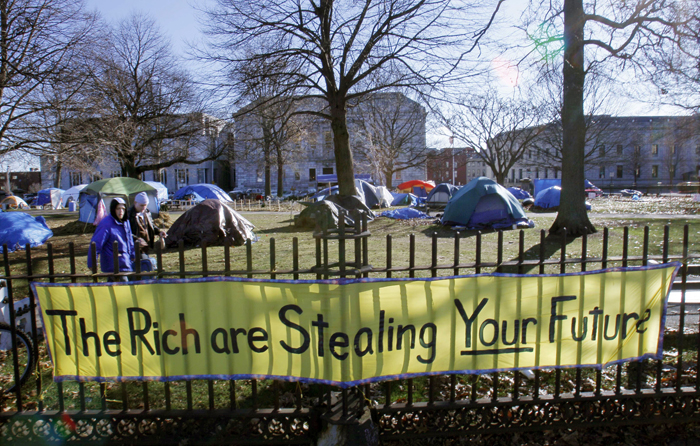 Occupy Maine protesters are unhappy with the lack of response from Portland police when the group reported that someone had removed signs from their Lincoln Park encampment (seen here in a Dec. 8, 2011, photo).