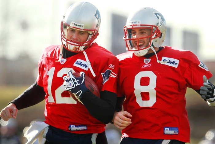 New England Patriots quarterbacks Tom Brady, left, and Brian Hoyer, right, perform field drills during a team practice in Foxborough, Mass., on Wednesday. The Patriots are scheduled to play the Denver Broncos in an AFC divisional playoff game Saturday, Jan. 14 in Foxborough.