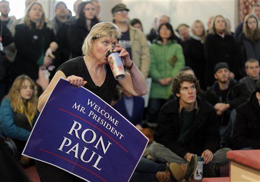 Kathleen Lawson sips coffee while listening to Ron Paul in Bangor.