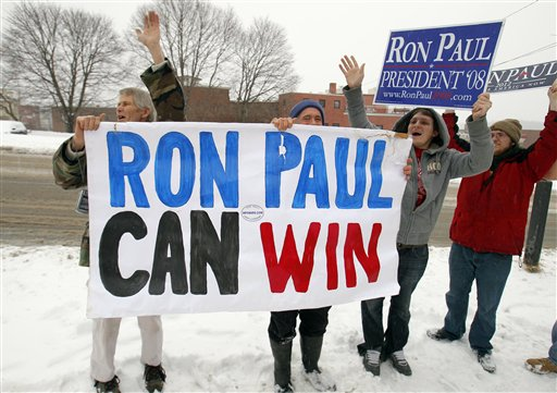 Supporters cheer as Ron Paul leaves a campaign stop in Bangor today.