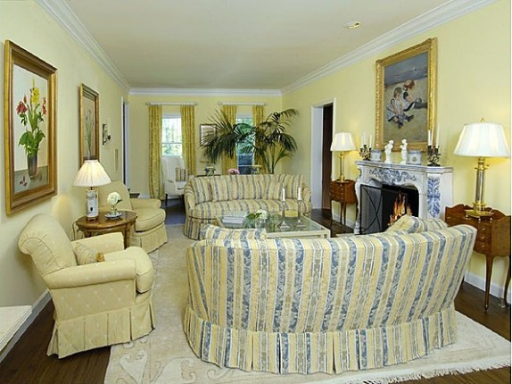 The living room in the home features a soft yellow color palette.