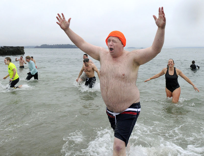 REFRESHING?: David Greenham, of Readfield, reacts after his plunge in the annual Polar Bear Plunge Saturday at the East End Beach in Portland.
