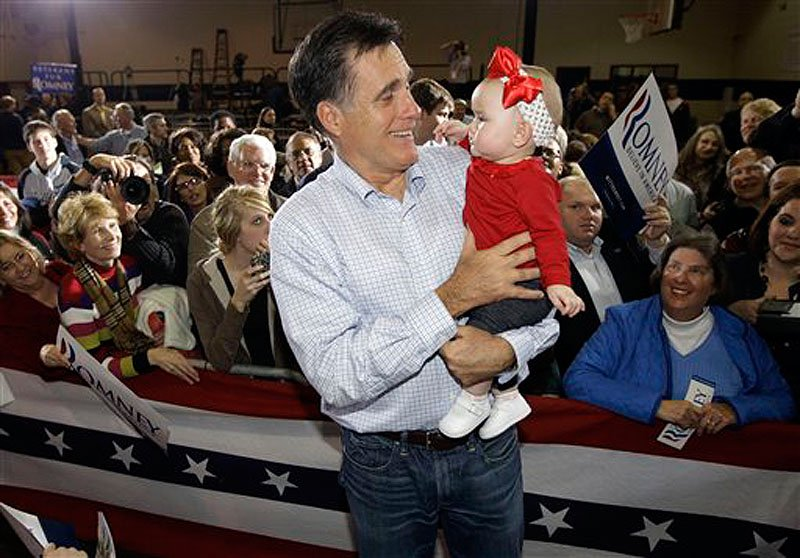 Republican presidential candidate, former Massachusetts Gov. Mitt Romney, carries 7-month-old Leah Locklear as he campaigns in Irmo, S.C. on Wednesday. (AP Photo/Charles Dharapak)
