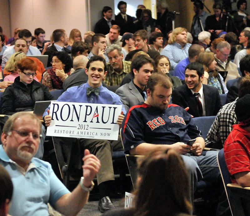 Staff photo by Michael G. Seamans Colby College junior, Brian Russo, center, displays his support for Republican Party presidential hopeful, Ron Paul at the Ostrove Auditorium at Colby College before Ron Paul speaks on Friday.