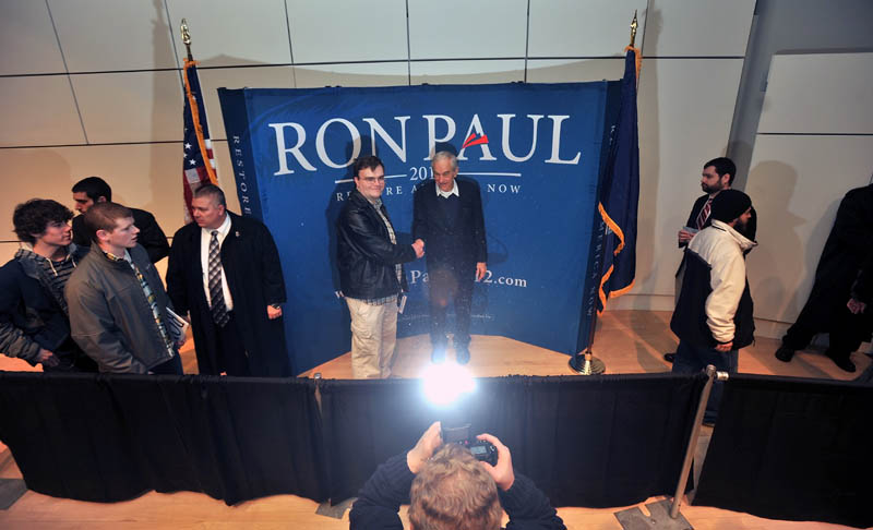 Staff photo by Michael G. Seamans Republican Party presidential hopeful, Ron Paul, greets supporters following a speech at the Ostrove Auditorium at Colby College on Friday.