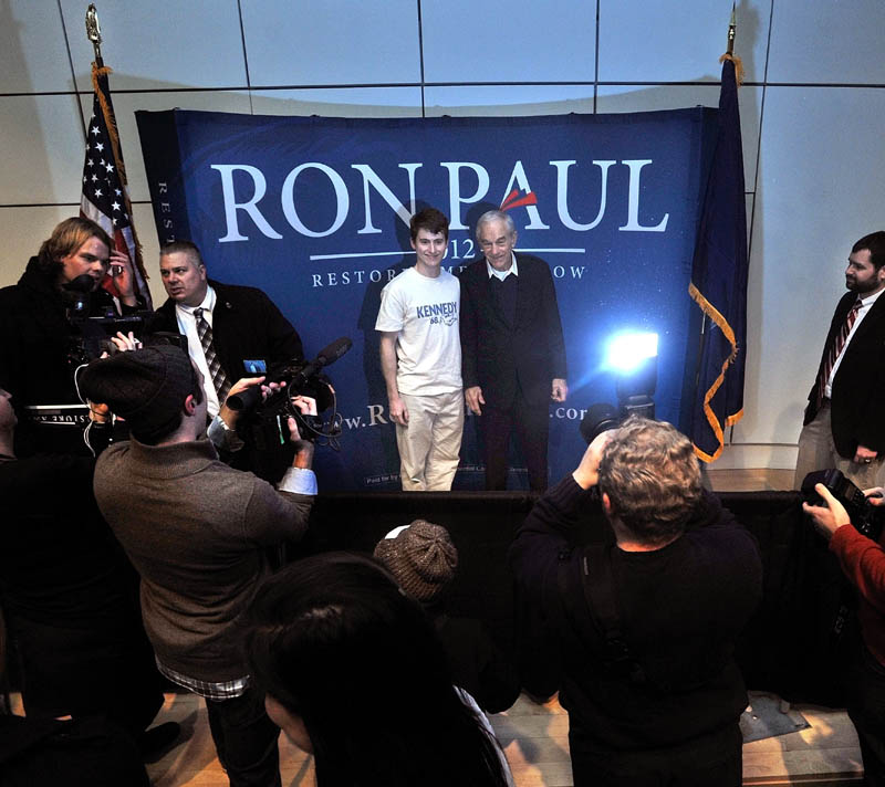 PAUL FAN: Colby College senior James Geoghegan poses for a picture with Ron Paul at Ostrove Auditorium at Colby College after a campaign speech on Friday.