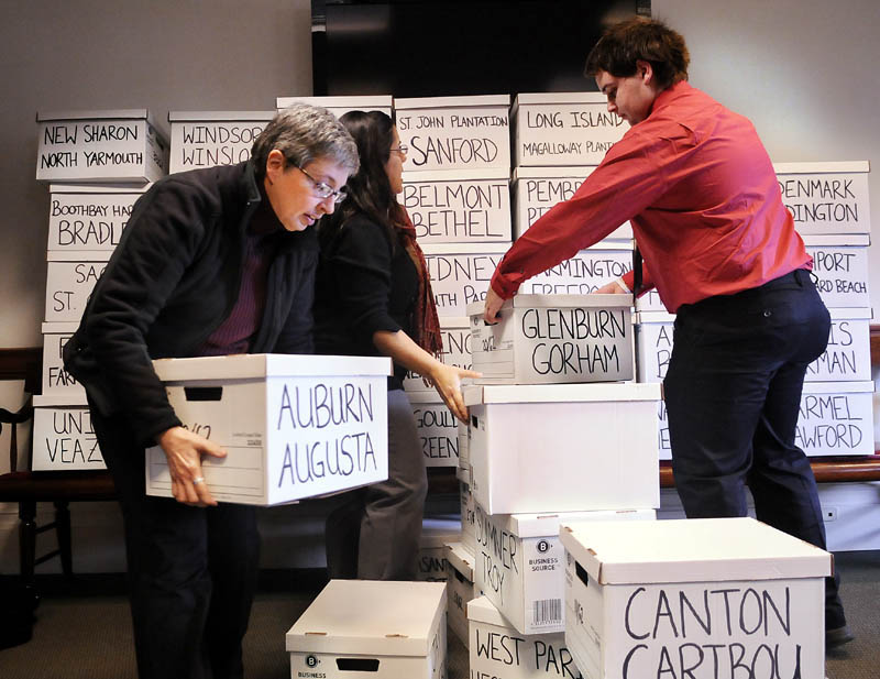 Volunteers stack boxes of signatures to put a same-sex marriage referendum on the ballot on Thursday in Augusta.