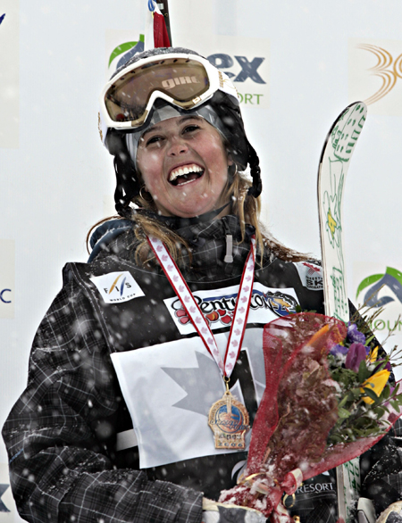 In this March 17, 2006, photo, Sarah Burke celebrates her gold medal in the halfpipe FIS World Cup event in Penticton, British Columbia.