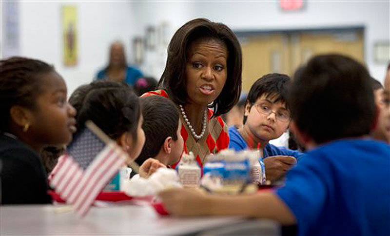 First lady Michelle Obama has lunch with school children at Parklawn elementary school in Alexandria, Va. on Wednesday, Jan. 25, 2012. (AP Photo/Pablo Martinez Monsivais)