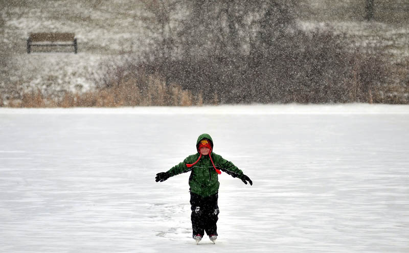 Tyler Margintan, 6, carefully skates across Johnson Pond at Colby College in Waterville as snow begins to fall on Thursday.