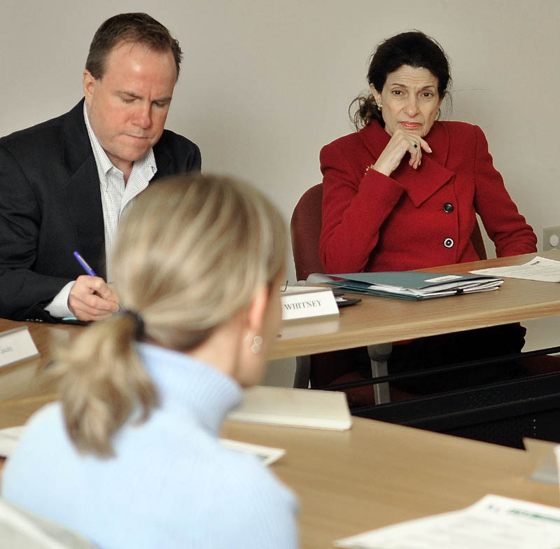 Sen. Olympia Snowe, top right, listens to Lori Williams, bottom left, describe her struggle to heat her home during a discussion about low-income heating assistance at the Kennebec Valley Community Action Program offices on Water Street in Waterville on Thursday afternoon. Brian Whitney, staffer for Sen. Snowe takes notes during the discussion.