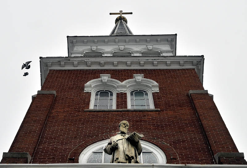 St. Francis de Sales Catholic Church on Elm Street in Waterville will be demolished in spring or early summer to make way for a 40-unit elderly housing facility.