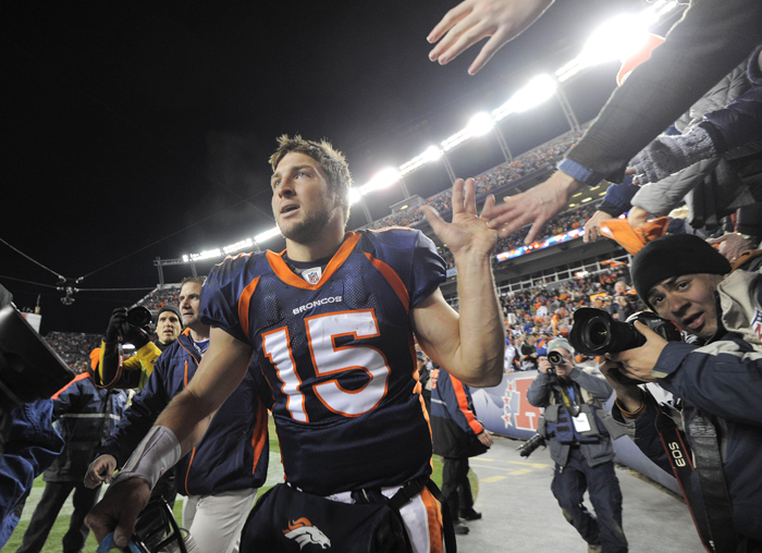 Denver Broncos quarterback Tim Tebow celebrates with fans after the Broncos defeated the Pittsburgh Steelers 29-23 in overtime of an NFL wild card playoff football game Sunday in Denver.
