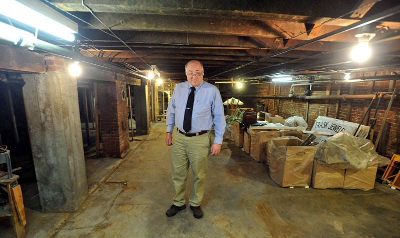 MESS: John Anderson, owner of Trask Jewelers Inc. in Farmington, stands in the basement of his store that was filled with water from a recent water main break.