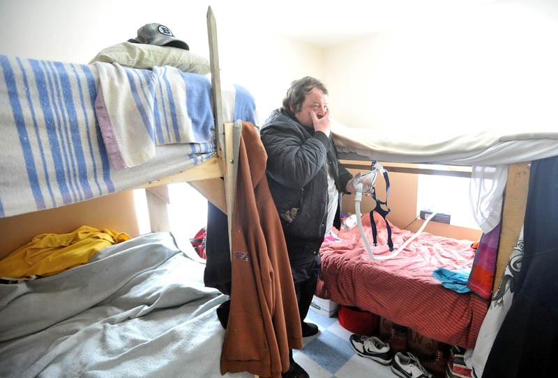 HOME: Brent Tweedie, 47, shows his bed at the Trinity Men's Homeless Shelter in Skowhegan Saturday morning. Tweedie has been a resident since July 2011.