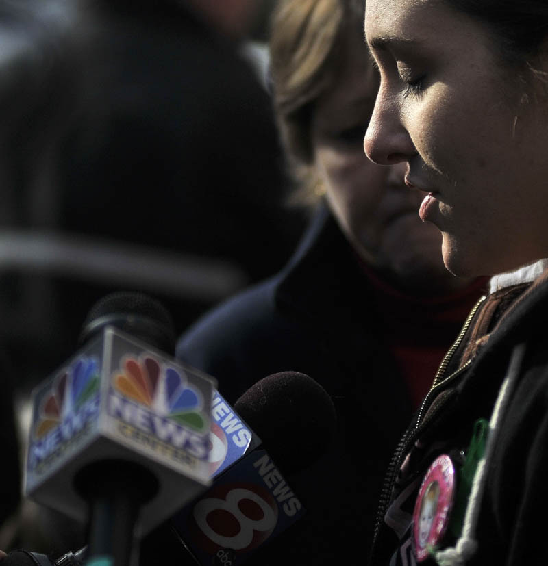 Staff photo by Michael G. Seamans Trista Reynolds talk with media during a vigil in Castonguay Square in Waterville for her missing toddler, Ayla Reynolds Saturday.