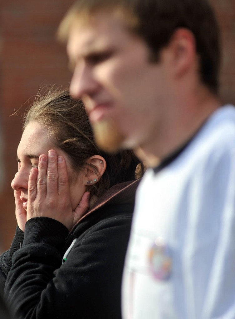 Staff photo by Michael G. Seamans Trista Reynolds, back, and Justin DePietro, speak to media during a vigil in Castonguay Square in Waterville for their missing toddler, Ayla Reynolds Saturday.