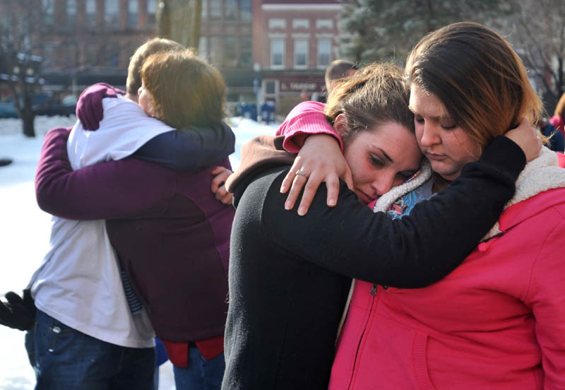 Staff photo by Michael G. Seamans Trista Reynolds, center, mother of Ayla Reynolds, is comforted by her friend Amanda Benner, during a vigil in Castonguay Square in Waterville for missing toddler, Ayla Reynolds Saturday.