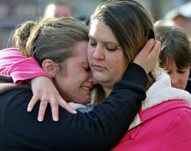 Staff photo by Michael G. Seamans Trista Reynolds, left, mother of Ayla Reynolds, is comforted by her friend Amanda Benner, during a vigil in Castonguay Square in Waterville for missing toddler, Ayla Reynolds Saturday.