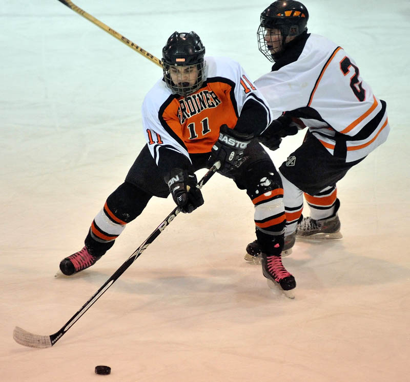 MAKE THE MOVE: Gardiner's Bryant Whitley, left, battles for the puck with Winslow High School's Jacob Cain in the first period Wednesday at Sukee Arena in Winslow.