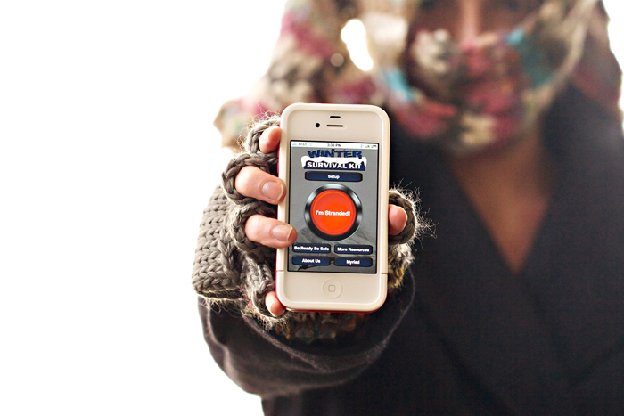 A smart phone displays the Winter Survival Kit, an application developed by Myriad Devices, a North Dakota startup company.