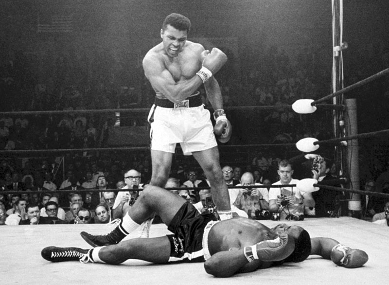 BIG MOMENT: Heavyweight champion Muhammad Ali stands over fallen challenger Sonny Liston, after dropping Liston with a short hard right to the jaw in Lewiston on May 25, 1965. Ali turns 70 on Tuesday.