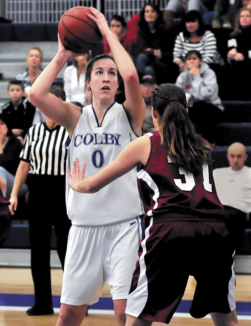 IMPACT PLAYER: Colby College's Rachael Mack, (0) looks for her shot against Bates' Brianna Hawkins during game Monday in Waterville. Mack scored her 1,000th point in the first quarter.