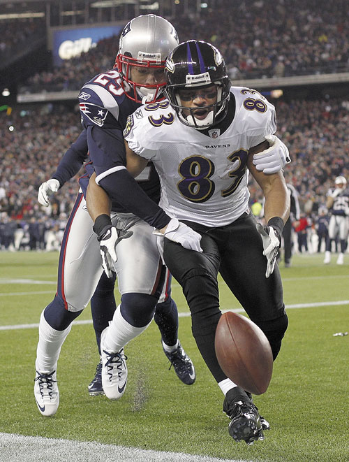 BIG PLAY: Baltimore Ravens wide receiver Lee Evans (83) is stripped of the ball by New England Patriots free safety Sterling Moore (29) during the second half of the AFC Championship game Sunday in Foxborough, Mass. The Patriots defeated the Ravens 23-20.