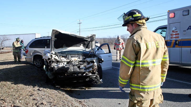 Staff photo by Ben McCanna Fairfield Fire Department and Fairfield Police responded Wednesday morning to a two-vechicle crash on U.S. Route 201 in which a child was transported to the hospital with injuries.