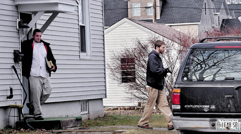 'BRING HER BACK': Justin DiPietro, right, leaves his mother's home at 29 Violette Ave. in Waterville on Monday, followed by his brother, Lance DiPietro. Justin DiPietro pleaded for the person who took his 20-month-old daughter, Ayla Reynolds, on Dec. 17 to return her to him.