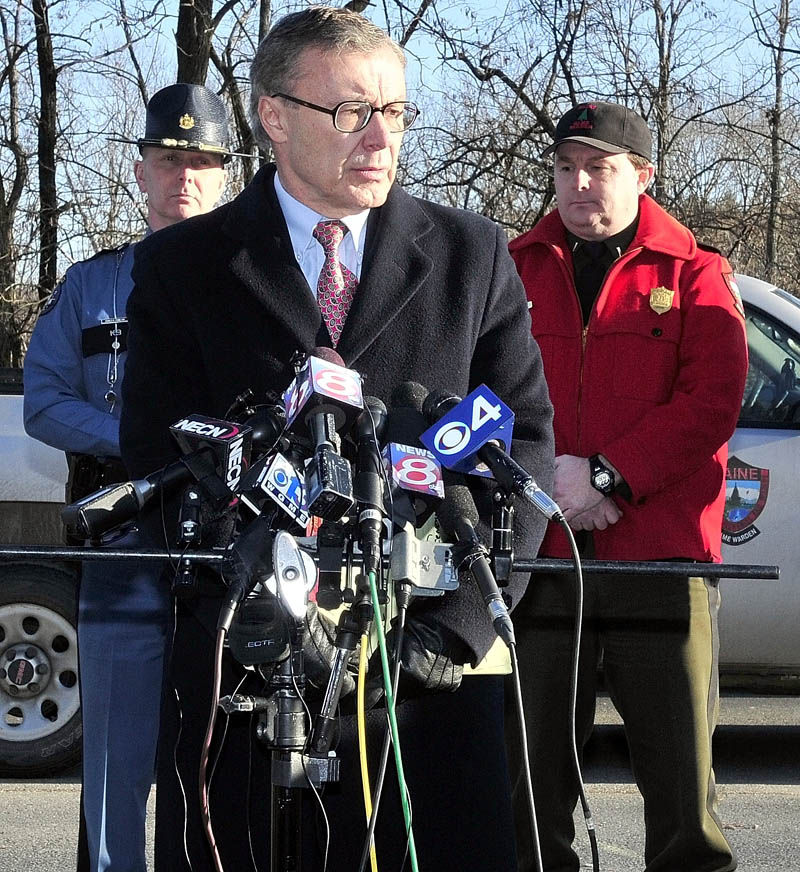 STATUS: Maine Department of Public Safety spokesman Steve McCausland addresses the media on the search for missing toddler Ayla Reytnolds in Waterville on Wednesday. Behind him is Lt. Don Pomelow, left, of the Maine State Police and Lt. Kevin Adams of the Maine Warden Service.