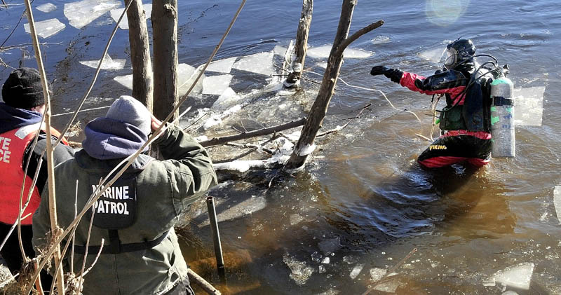 HARD SEARCH: Maine State Police diver Jarod Stedman encountered sunken wood and floating pieces of ice while searching underwater for signs of missing toddler Ayla Reynolds in the Kennebec River in Waterville on Wednesday.