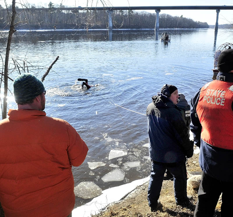 MASSIVE SEARCH: A diver heads back underwater as a search boat motors above the Carter Memorial Bridge in the Kennebec River as state police and the Maine Warden Search conducted an extensive search of the river for signs of missing toddler Ayla Reynolds on Wednesday.