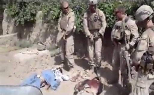 This image is from an undated video posted on the Internet on Wednesday, Jan. 11, 2012 by a YouTube user, which purports to show four U.S. Marines urinating on the corpses of Taliban fighters. (AP Photo)