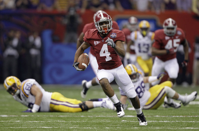 BUSTING LOOSE: Alabama's Marquis Maze returns a punt 49 yards during the first half of the BCS national championship game against LSU on Monday night in New Orleans. While the return led to a field goal and the game's first points, Maze soon left with an apparent hamstring injury.