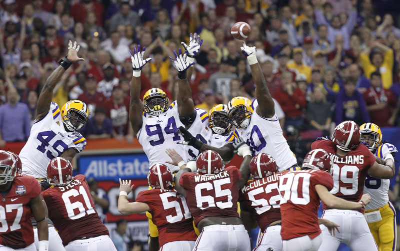 STUFFED: LSU defensive tackle Michael Brockers (90) blocks an Alabama field goal attempt during the first half of the BCS national championship game Monday night in New Orleans.