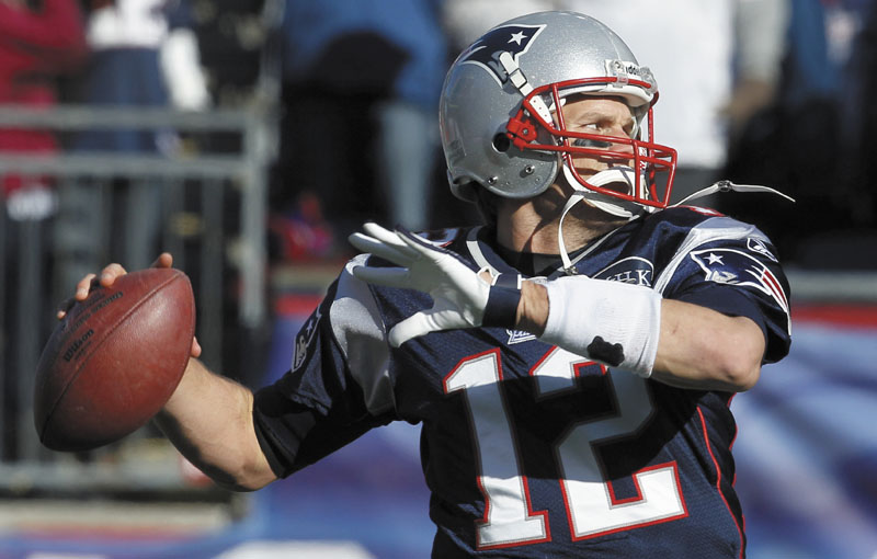 AP photo ON THE VERGE OF HISTORY: New England quarterback Tom Brady needs 103 yards to become the third quarterback to surpass 5,000 passing yards in a season when the Patriots host the Bills in their regular-season finale today.